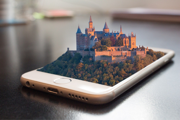 Phone that shows a castle and a big garden emerging off the screen because of VR and AR reality, this is augmented and virtual reality a form of advanced technology